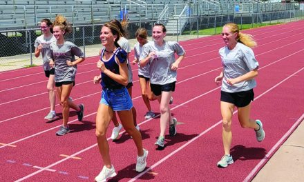 Olympic-Runner McGee Honored by Pass Christian, Conducts Wellness Event