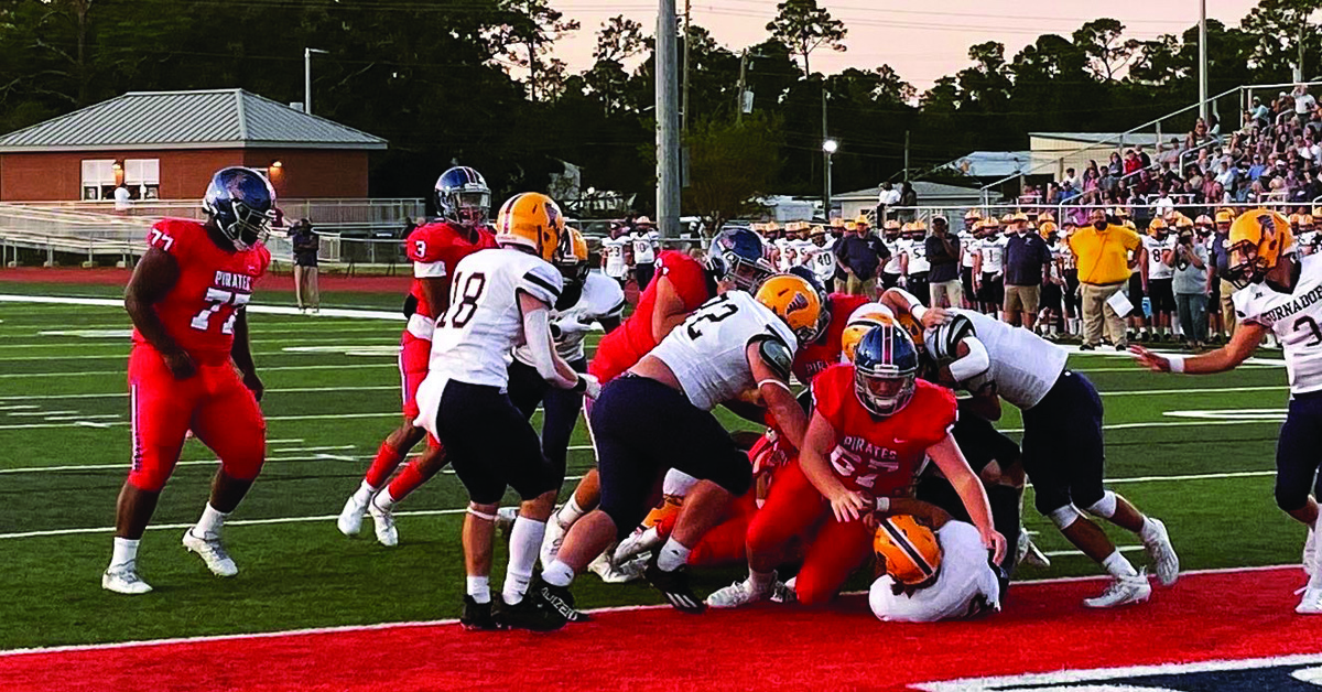 White's Five Touchdowns Leads Pirates to 41-14 Win